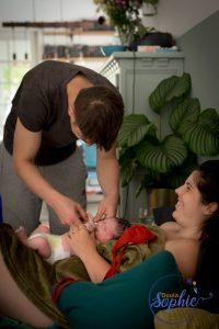 Daddy dressing baby- Home birth -Jip